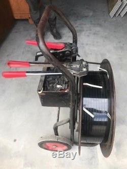 Strapping Machine With Tools And Material