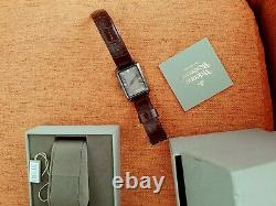 Vivienne Westwood Time Machine Watch with a Brown Strap, Silver Dial